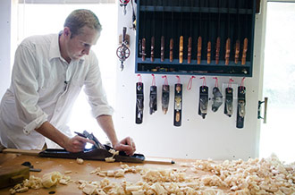 Joshua Farnsworth Handplaning A Board On A Sjobergs Workbench