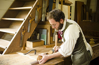 Bill Pavlack Handplaning On A Woodworking Bench Which Is An Antique Wooden Workbench