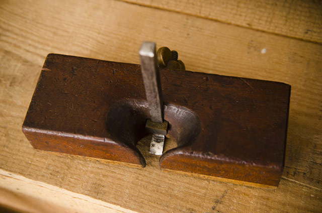 Wood Plane: Top view of an antique wood router plane called an old woman's tooth router