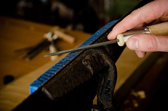Hand Saw Sharpening With A File On A Cast Iron Saw Vise