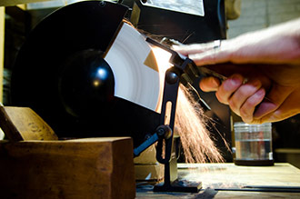Hand Plane Sharpening On A Slow Speed Grinder With Aluminum Oxide Wheel Making Sparks