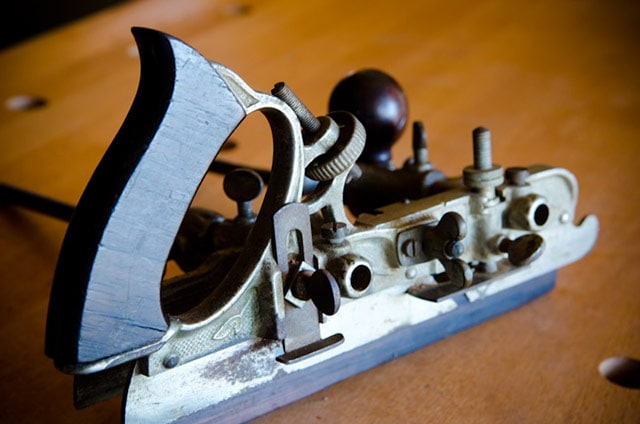 stanley planes: alternate side of a stanley 45 combination plane sitting on a woodworking workbench