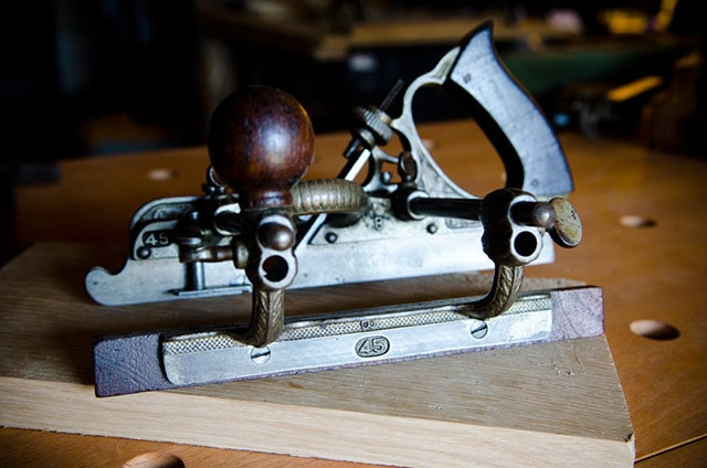 stanley planes: stanley 45 combination plane sitting on a woodworking workbench
