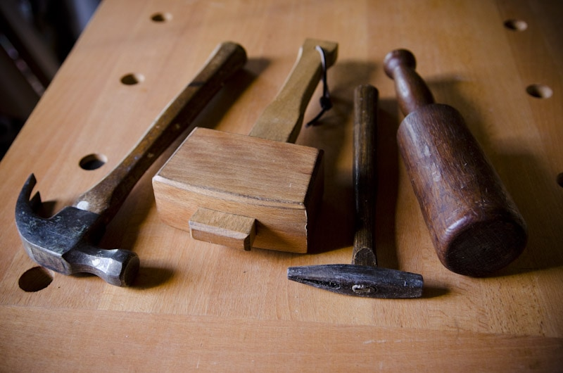 Hammers and woodworking joiner's mallets and carving mallet on a woodworking workbench