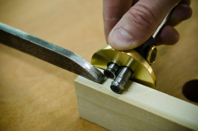 Using A Mortise Gauge To Mark A Mortise Size Next To A Mortise Chisel On A Mortise And Tenon Joint