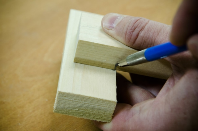 Using A Pencil To Mark The Shoulder Line Of A Mortise And Tenon Joint