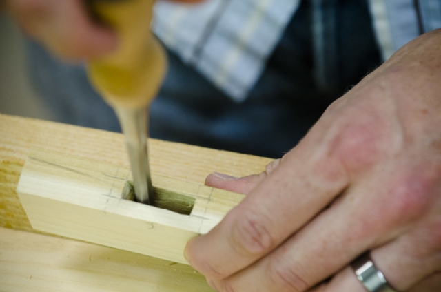Using A Bench Chisel To Clean A Mortise