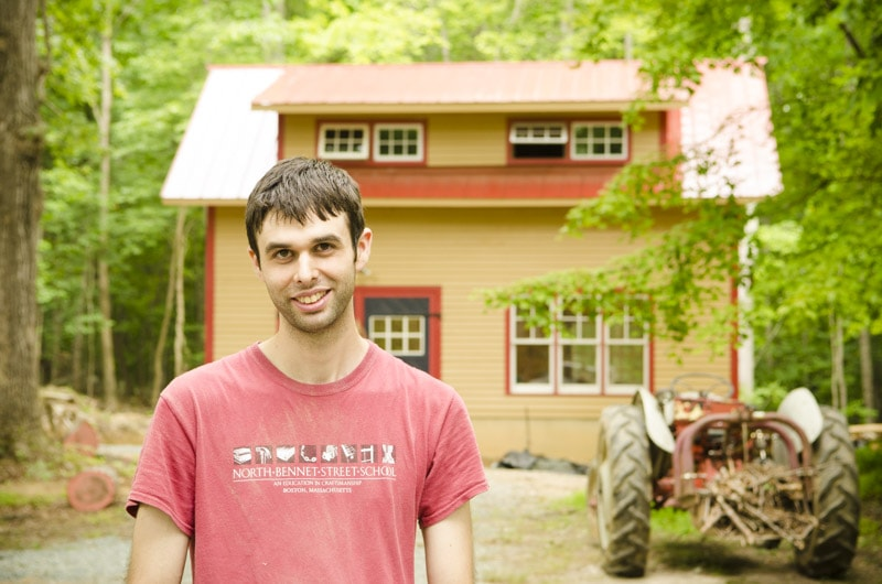 Windsor Chair maker Elia Bizzarri standing in front of his North Carolina workshop with a tractor