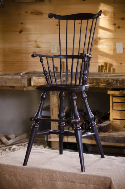 Windsor Child High comb back Chair made by Elia Bizzarri in his North Carolina woodworking workshop with a woodworking workbench