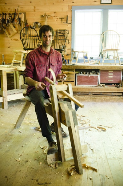 Elia Bizzarri sitting at his shaving horse making a Windsor Chair in his North Carolina workshop