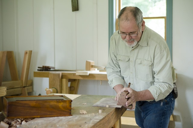 David Ray Pine Using A Moving Fillister Rabbet Plane Woodworking Hand Tool On A Moravian Workbench In A Wood Shop
