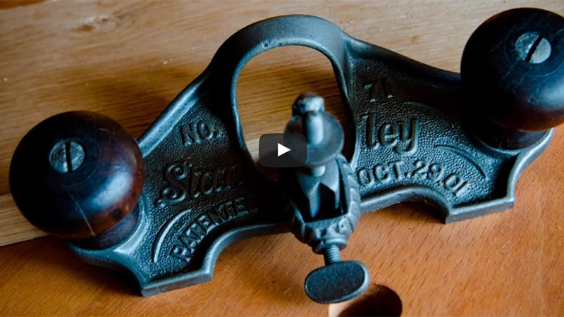 stanley 71 router plane sitting on a woodworking workbench