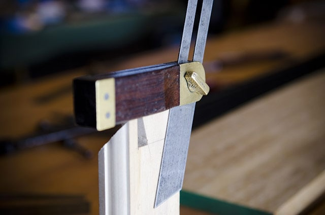 sliding angle bevel square gauge measuring dovetail angle on a board