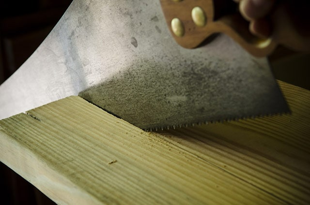 Disston hand saw rip cutting along the grain of southern yellow pine board