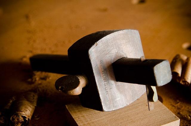 Antique cutting marking gauge sitting on a woodworking workbench
