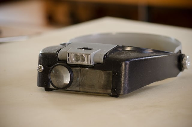 Magnification head lamp for hand saw sharpening