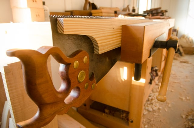 Wooden hand saw vise and Disston D-8 Rip hand saw in a woodworking workbench vise