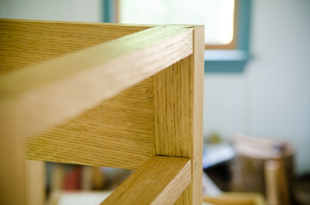 Drawer rails attached to a table leg with lap dovetail joint and double mortise and tenon joint
