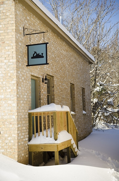 snowy exterior of wood and shop traditional woodworking school
