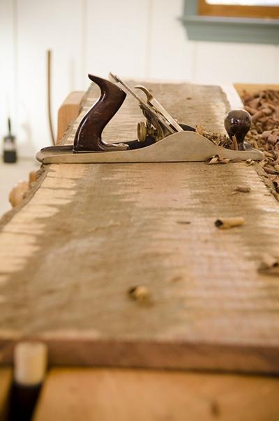 Scrubbing a rough board with a fore plane or scrub plane