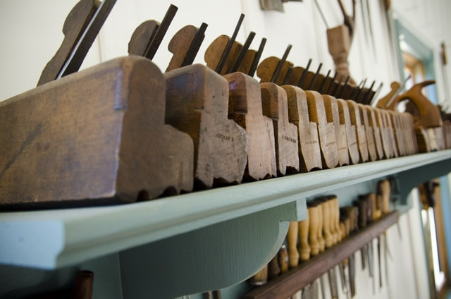 moulding planes and chisels on a shelf in woodandshop woodworking school