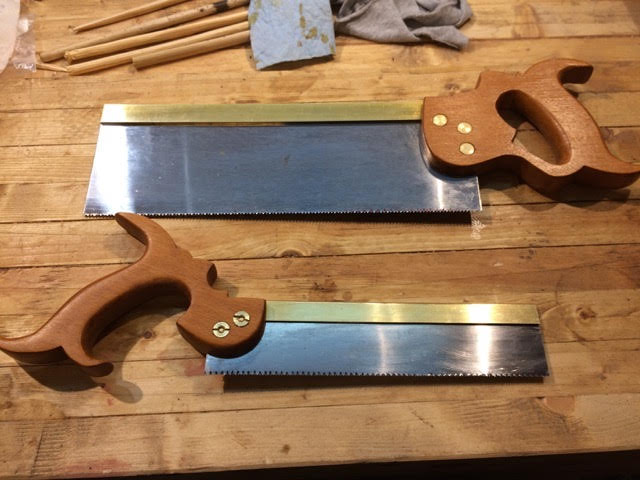 custom made Dovetail saw and tenon saw sitting on a woodworking workbench