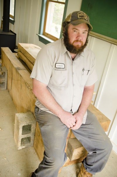 Lesley Caudle mill write sitting on stack of workbench slabs