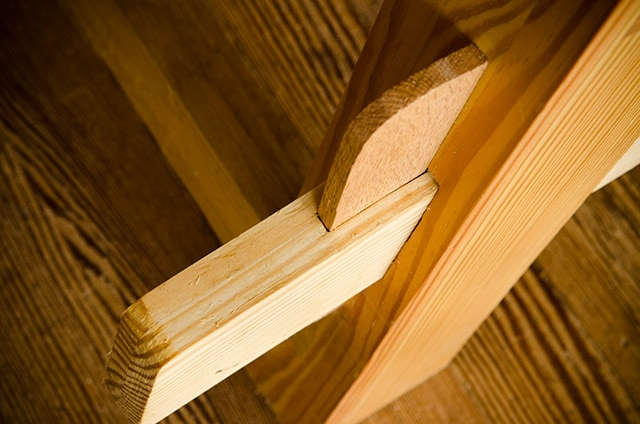 Closeup of a wedged tusk tenon joint or keyed tenon joinery on a Moravian workbench