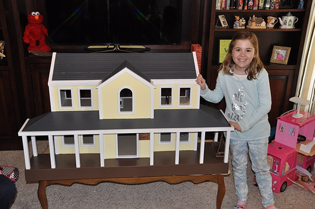 Little Girl With A Yellow Doll House Built By James Huggett