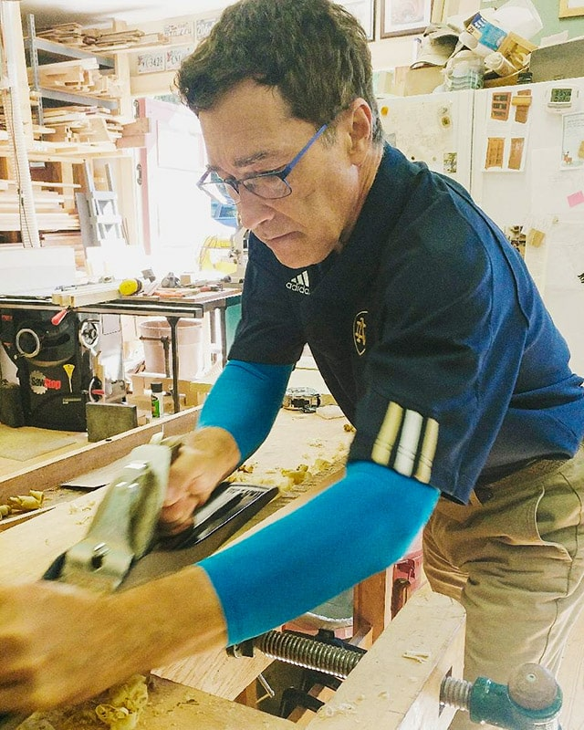 Dave Heller using a handplaner in his woodworking workshop