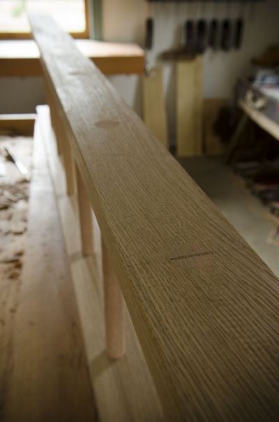 Custom made wedged white oak ladder on a woodworking workbench