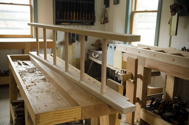 Custom made wedged white oak ladder on a woodworking workbench