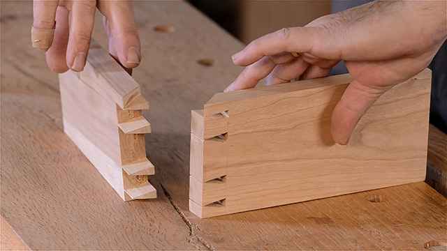 Dave Heller holding two boards with a London style dovetail joint
