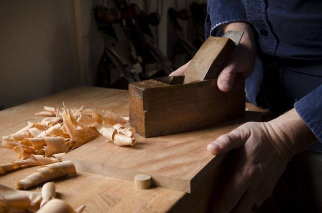 Coffin smoother smoothing plane planing shavings on a cherry board