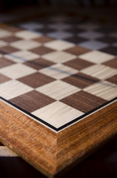Dave Heller holding a veneered chess board with mother of pearl inlay
