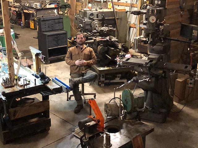 Erik Florip Sitting In His Florip Toolworks Workshop