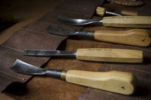 Swiss made carving gouges on a leather tool roll