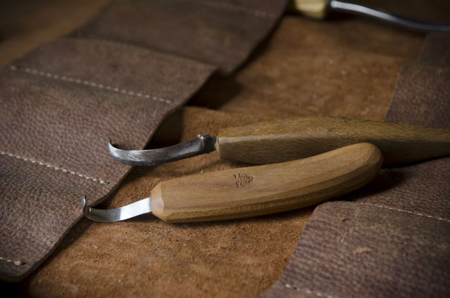 Green woodworking Hook knives on a leather tool roll
