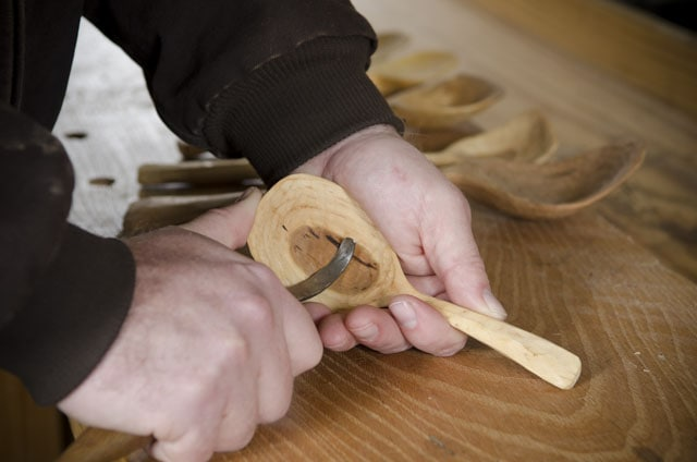 Mike Cundall carving a wooden spoon with a hook knife, or spoon knife or crook knife