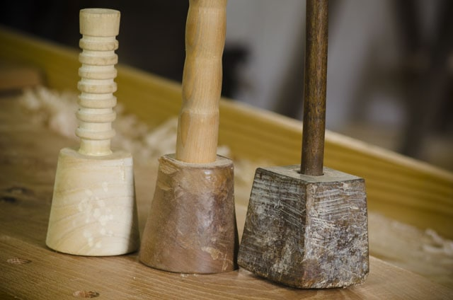wood carving mallets on a woodworking workbench