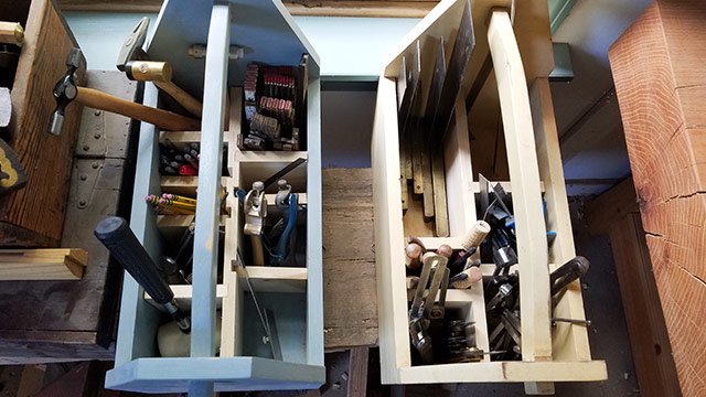 Woodworking tool totes with wooden dividers with marking and measuring tools