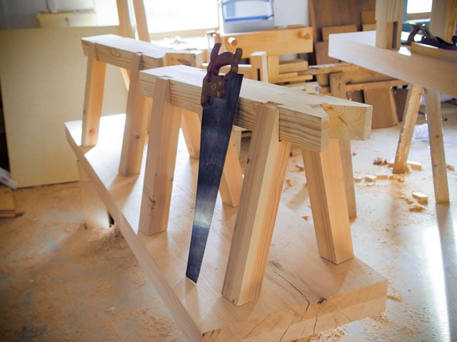 timber framing saw benches with a woodworking hand saw
