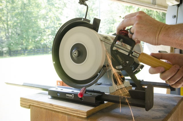 Wolverine Grinding System with VARI-GRIND jig sharpening a detail spindle gouge for woodturning