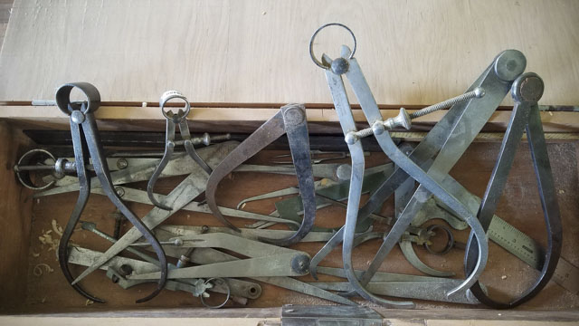 Box full of antique vintage calipers