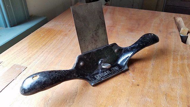 Stanley No. 80 hand scraper plane sitting on a woodworking workbench