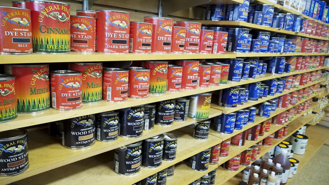 woodworking store shelves full of cans of wood finish