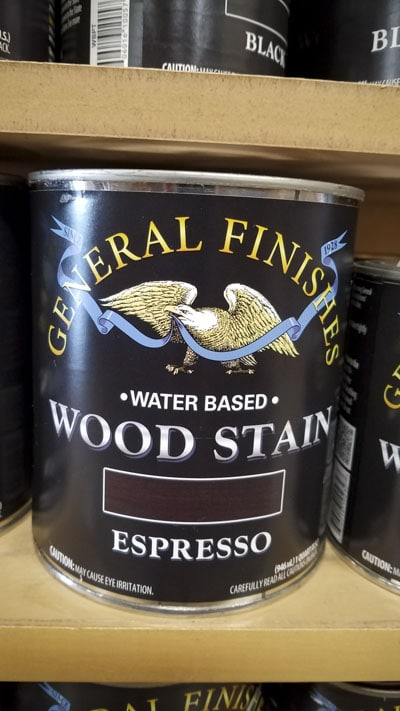 Gallon Can Of General Finishes Water Based Wood Stain Espresso Color Sitting On A Shelf In A Woodworking Store