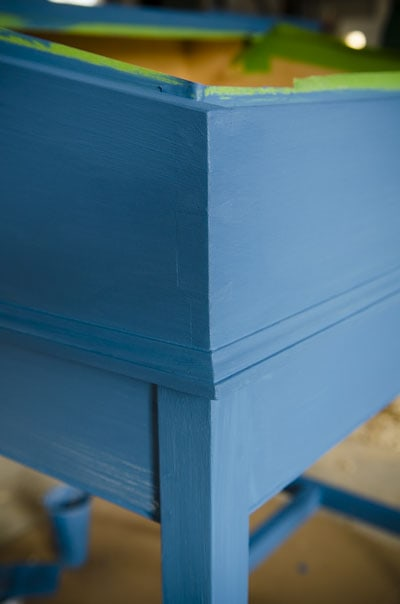 Painting a wooden school master's desk with blue chalk paint