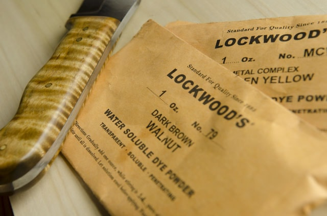 Lockwood'S Water Soluable Dye Powder For Woodworking With A Tiger Figured Maple Knife