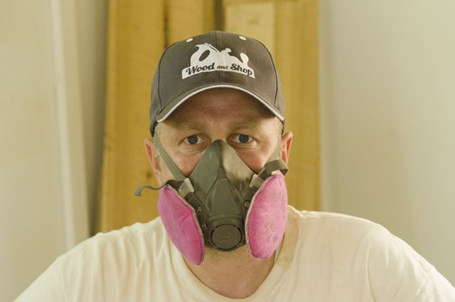 Joshua Farnsworth with a dust mask with a wood and shop hat